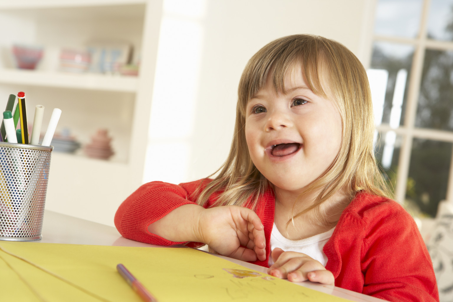 Girl with Downs Syndrome drawing
